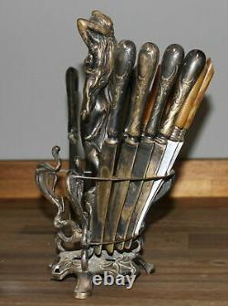 Ancien porte-figurine femme nue en laiton argenté Art Nouveau 12 couteaux