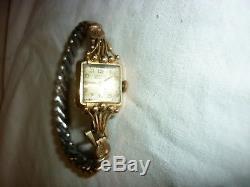 Ancienne montre femme OR 18K 750 carat tête d'aigle art nouveau déco