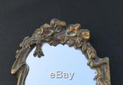 Miroir face à mains. Bronze art nouveau décor femme et fleurs